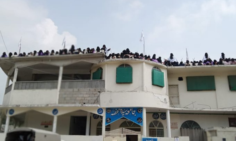 Afghan Taliban flags are seen flying on the rooftop of Jamia hafsa in Islamabad on Saturday. — Photo courtesy Zahid Gishkori Twitter
