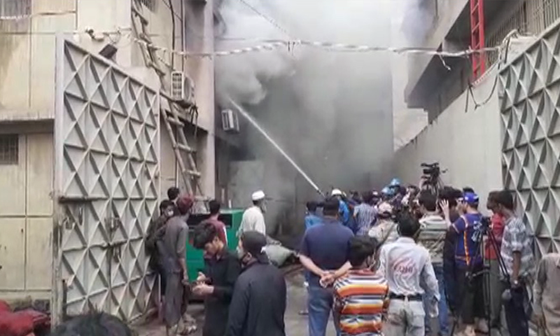 Firefighters try to put out the blaze after a factory caught fire in Karachi's Mehran Town. — DawnNewsTV/File