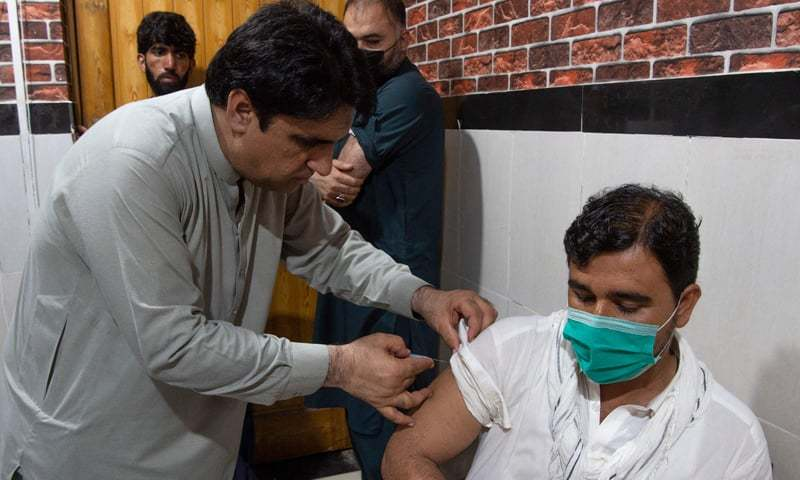 An overseas Pakistani worker who wants to fly to the Middle East receives a dose of the Moderna vaccine at a vaccination center in Peshawar. — AFP/File