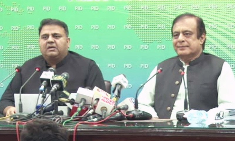 Information Minister Fawad Chaudhry (L) and Science and Technology Minister Shibli Faraz (R) address a press conference in Islamabad. — DawnNewsTV