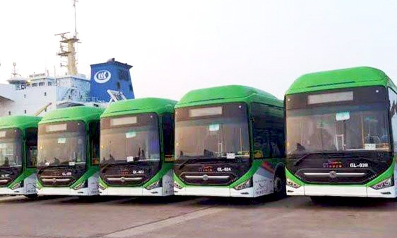 The newly arrived Green Line buses are seen at Karachi Port. — DawnNewsTV