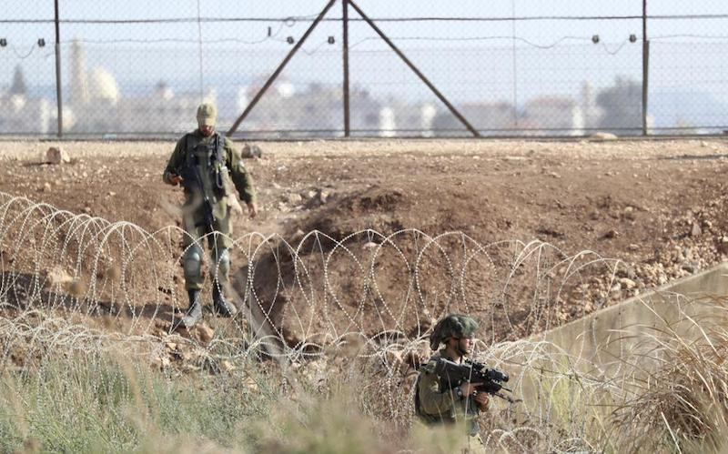Israeli soldiers take positions along the border between the northern West Bank near Jenin and Israel as they search for two Palestinians who broke out of a maximum-security prison last week, on a road leading to the West Bank town of Jenin, near Gan Ner Israel. The last two of six Palestinian prisoners who escaped a maximum-security Israeli prison two weeks ago were rearrested early on Sunday, Sep 19, the Israeli military said. — AP
