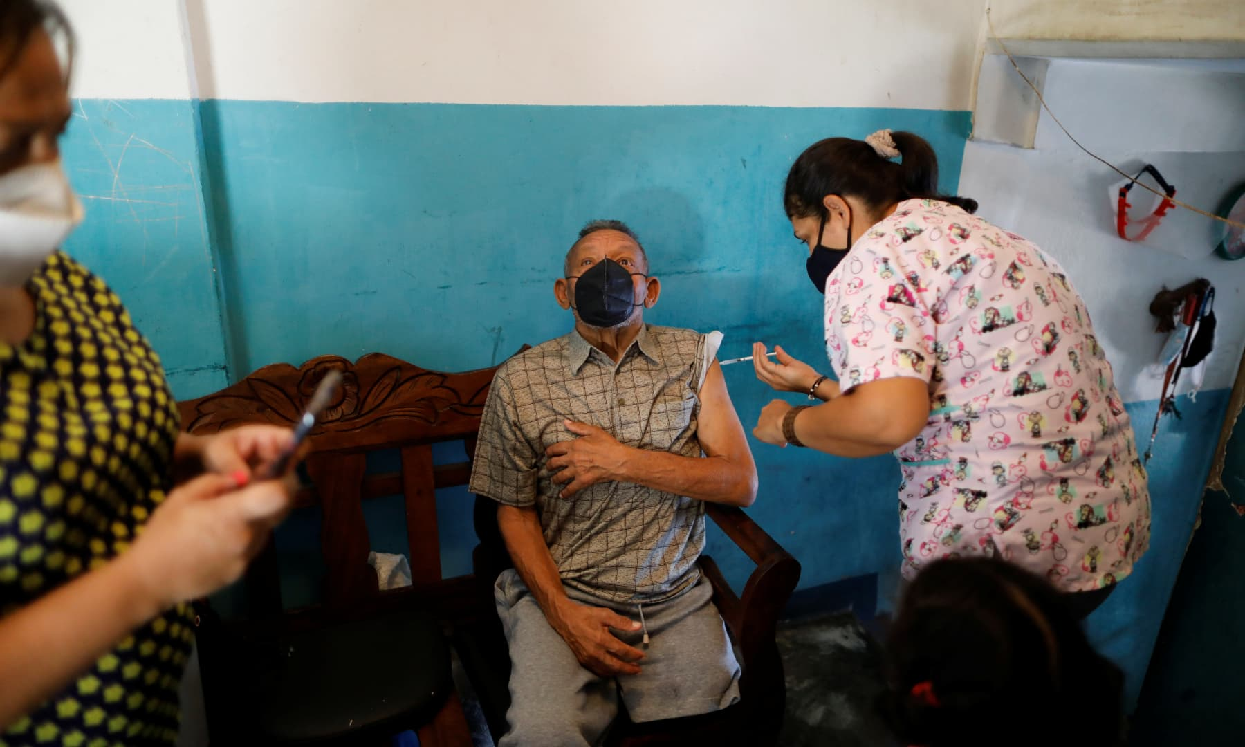 A man receives a dose of the Sinopharm vaccine against the coronavirus as healthcare workers go from door to door to inoculate the elderly and people with disabilities, in Caracas, Venezuela, on September 18, 2021. — Reuters