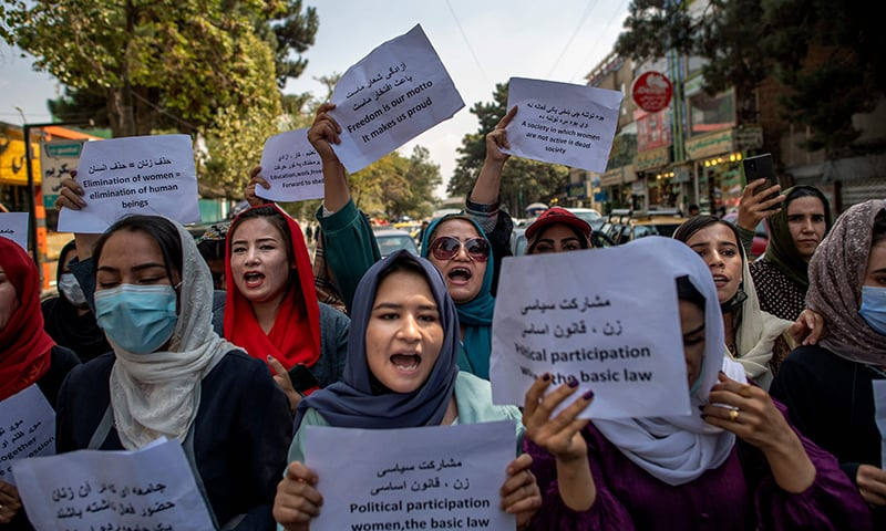 Afghan women hold placards during a demonstration demanding better rights for women in front of the former Ministry of Women Affairs in Kabul on September 19. — AFP