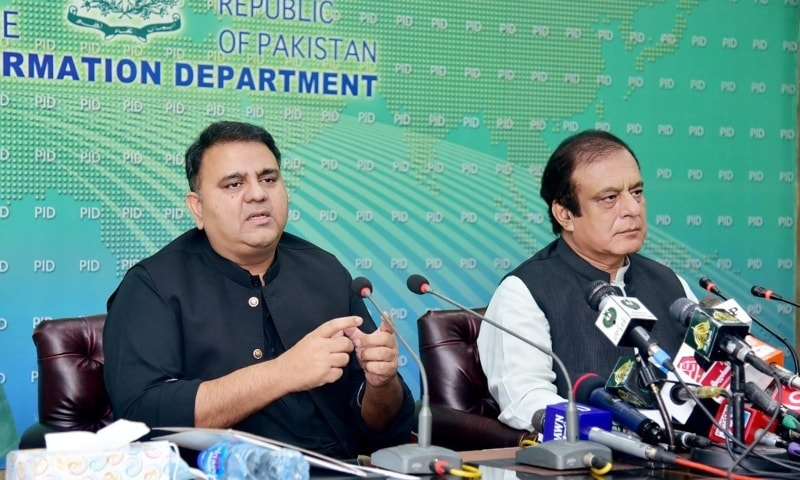 Federal Minister for Information Fawad Chaudhry (left) and federal Minister for Science and Technology Shibli Faraz address a press conference in Islamabad on Sunday. — Photo courtesy: PID