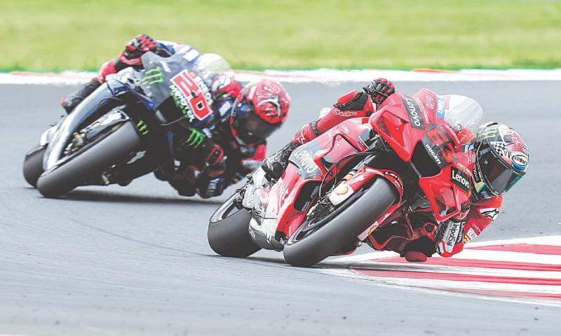 MISANO ADRIATICO: Italy's Francesco Bagnaia rides his Ducati ahead of Yamaha's Fabio Quartararo of France to win the San Marino MotoGP on Sunday. — AP
