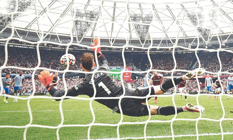 LONDON: Manchester United goalkeeper David de Gea saves a penalty from West Ham United's Mark Noble during their Premier League match at the London Stadium on Sunday. — Reuters