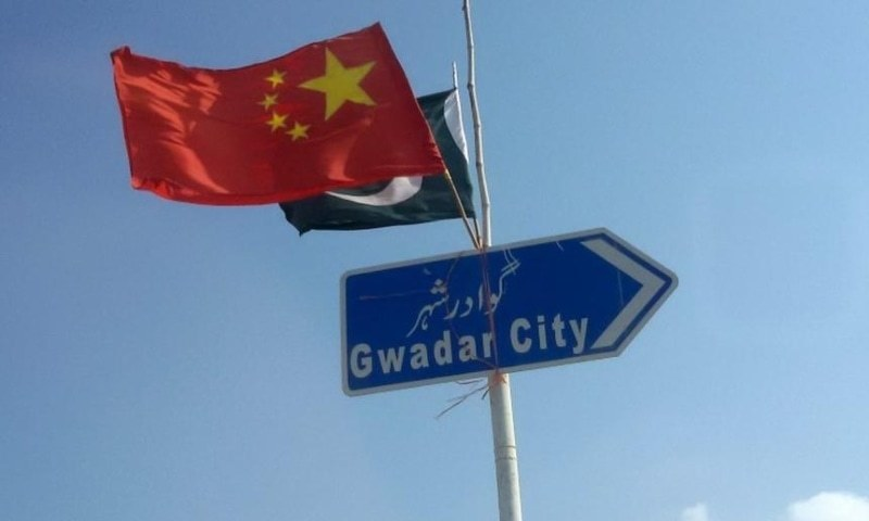 In this 2016 file photo, the Chinese and Pakistani flags fly on a sign along a road towards Gwadar. — Reuters/File