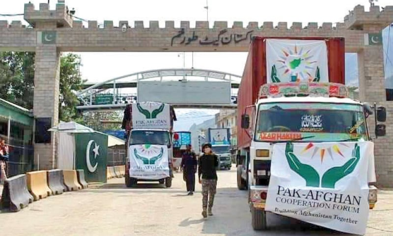 Container trucks carrying food items cross Torkham border to enter Afghanistan on Sunday. — Dawn