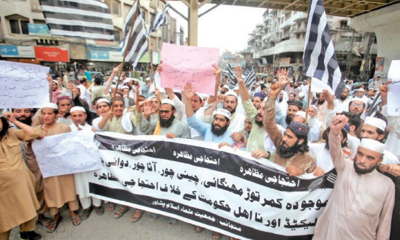 JUI-F activists stage a protest against price hike at Shoba Chowk, Peshawar, on Sunday. — White Star