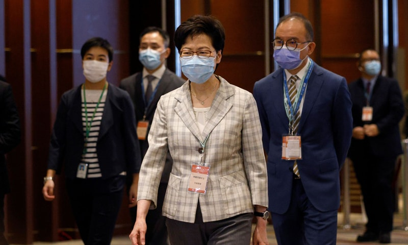 Hong Kong Chief Executive Carrie Lam visits a polling station during voting of the election committee in Hong Kong. — Reuters
