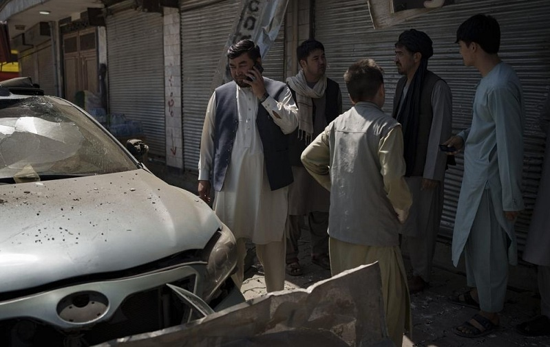 Afghans gather at the site of an explosion in Kabul on Saturday, Sept. 18, 2021. — AP