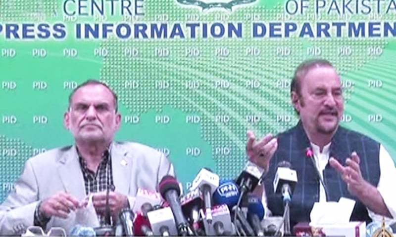 Railways Minister Azam Swati and  Adviser to the Prime Minister on Parliamentary Affairs Babar Awan address a press conference in Islamabad. — DawnNewsTV