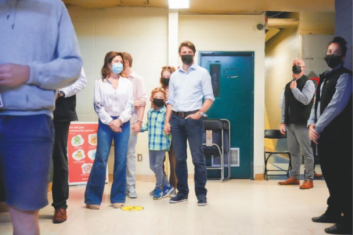 CANADA'S Prime Minister Justin Trudeau and his wife Sophie Gregoire at a polling station in Montreal.—Reuters