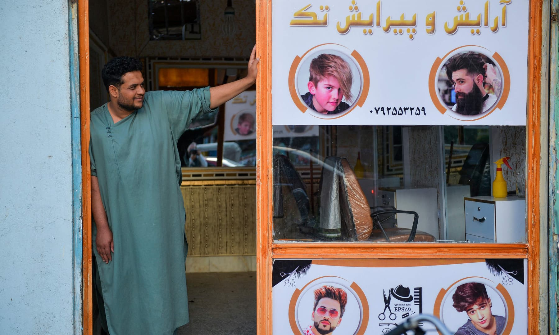 A barber waits for customers at his shop in Herat, Afghanistan on September 19, 2021. — AFP