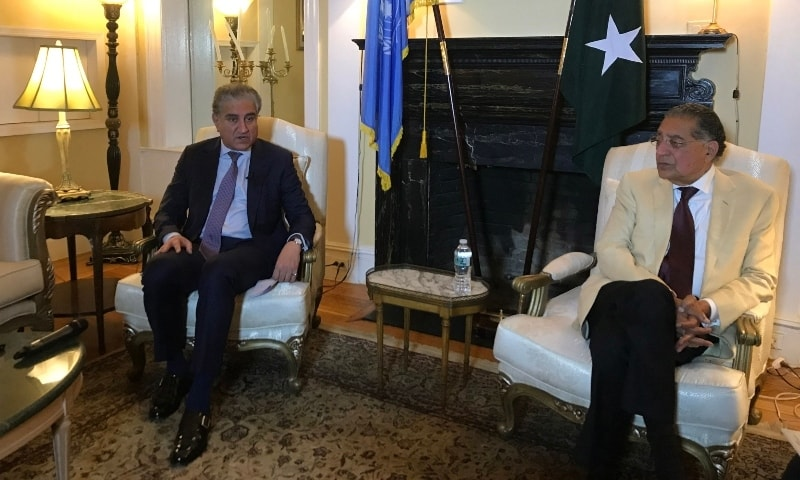 Foreign Minister Shah Mahmood Qureshi (L) sits with Pakistan's Ambassador to the UN Munir Akram as they speak to AFP on the sidelines of the high-level 76th session of the UN General Assembly in New York on September 20. — AFP
