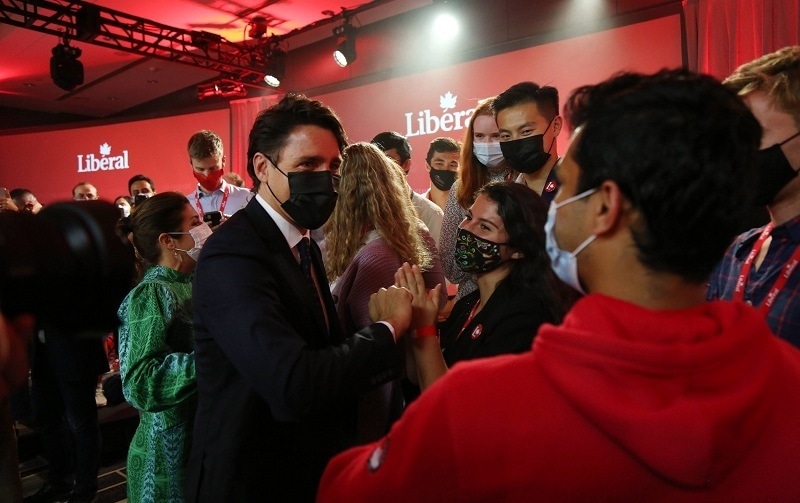 Canada's Prime Minister and Liberal Party Leader Justin Trudeau greets supporters after his victory speech at election headquarters on Sep 20 in Montreal, Canada. — AFP