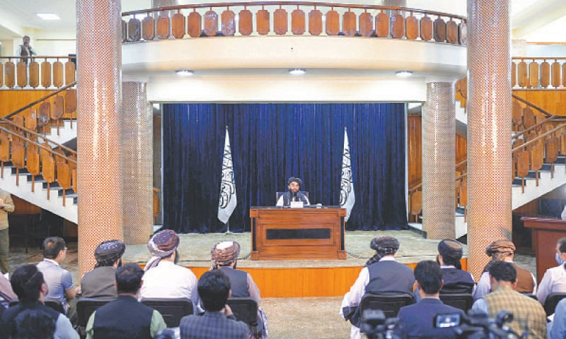 KABUL: Chief spokesman for the Taliban Zabihullah Mujahid speaks at a press conference on Tuesday.—AFP