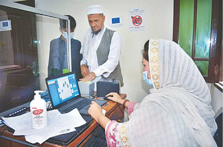PESHAWAR: Afghan refugees getting themselves registered at the Afghan Registration Centre on Tuesday.—APP