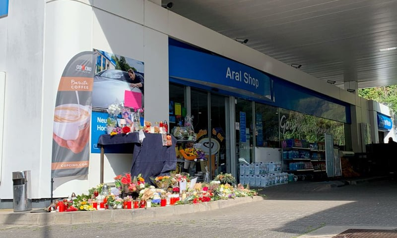 Flowers are placed in front of a gas station in Idar-Oberstein, Germany,  on September 21, 2021, after a 20-year-old gas station attendant who asked a customer to wear a face mask was shot dead last Saturday. — Reuters