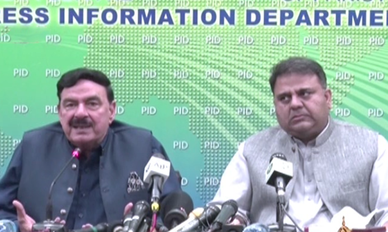 Interior Minister Sheikh Rashid Ahmed (left) and Minister for Information and Broadcasting Fawad Chaudhry address a press conference in Islamabad. — DawnNewsTV