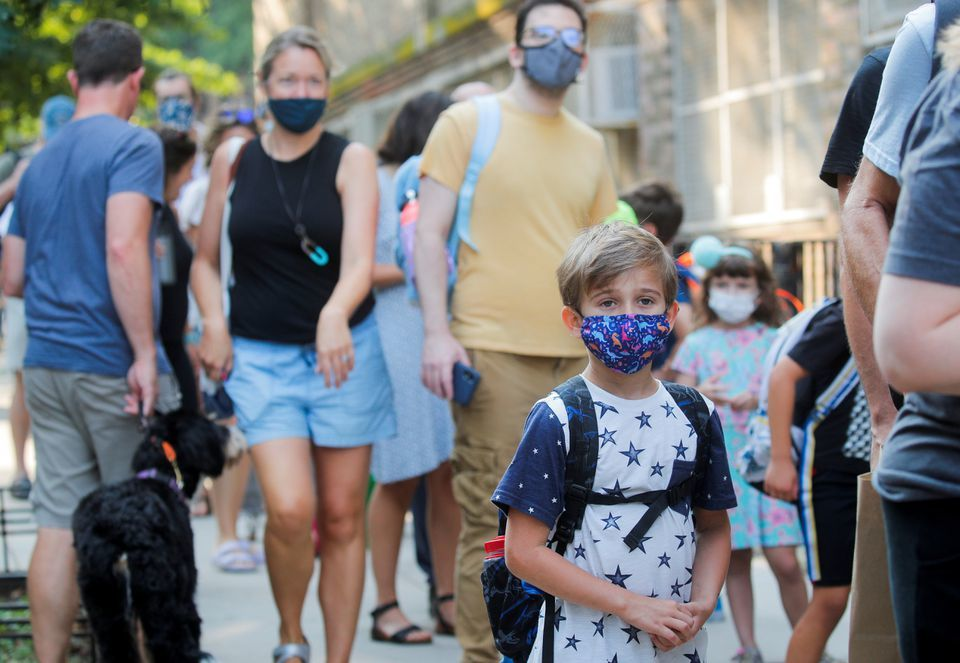 A child wears a face mask on the first day of New York City schools reopening in Brooklyn, New York, US, on September 13. — Reuters