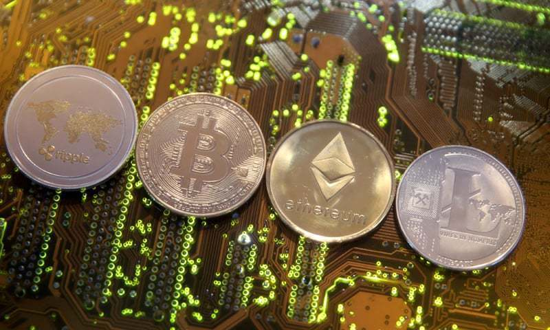 Representations of the Ripple, Bitcoin, Etherum and Litecoin virtual currencies are seen on a PC motherboard in this illustration picture. — Reuters/File