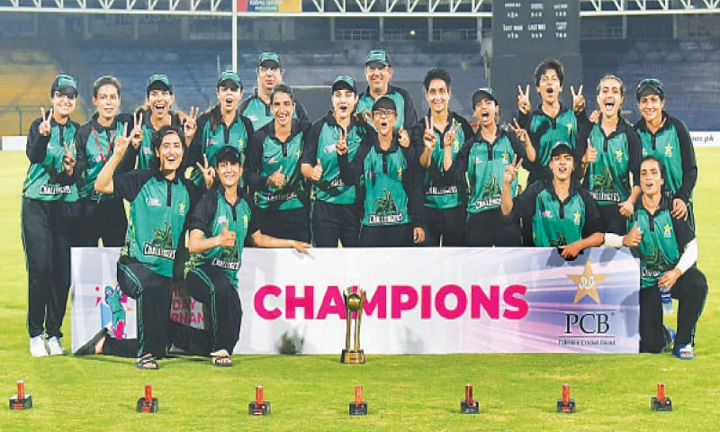 KARACHI: The victorious PCB Challengers squad members celebrate with the Women's Pakistan Cup trophy at the National Stadium.—Courtesy PCB