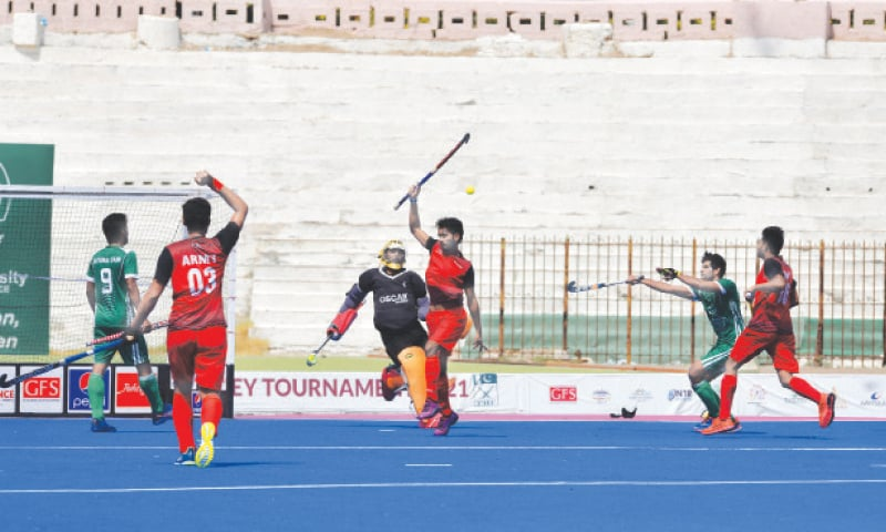 KARACHI: Pakistan Army goalkeeper Mohammad Majid clears the ball away during the CNS All Pakistan Hockey Championship match against National Bank of Pakistan at the Abdul Sattar Edhi Stadium on Wednesday.—Shakil Adil/White Star