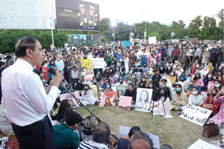 Former ambassador Shaukat Mukadam speaks to participants of a vigil held in memory of his daughter, Noor, outside the National Press Club in Islamabad on Wednesday. — Photo by Mohammad Asim