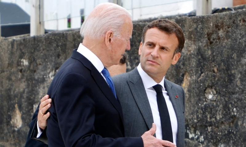 In this file photo US President Joe Biden (L) and France's President Emmanuel Macron speak after the family photo at the start of the G7 summit in Carbis Bay, Cornwall on June 11. — AFP