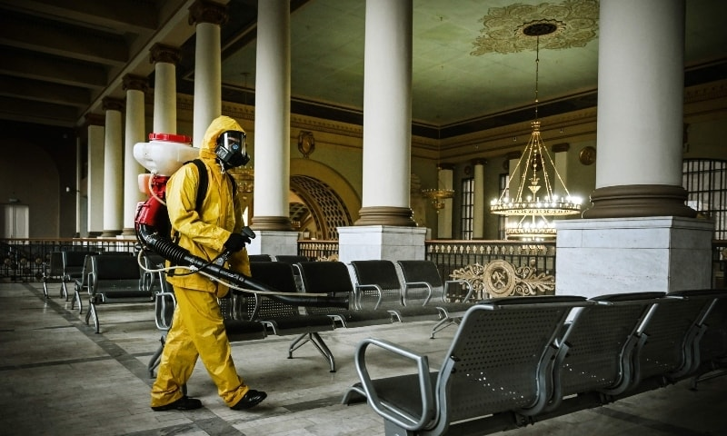 A serviceman of Russia's Emergencies Ministry, wearing protective gear, disinfects Kievsky railway terminal amid the Covid-19 pandemic in Moscow. — AFP
