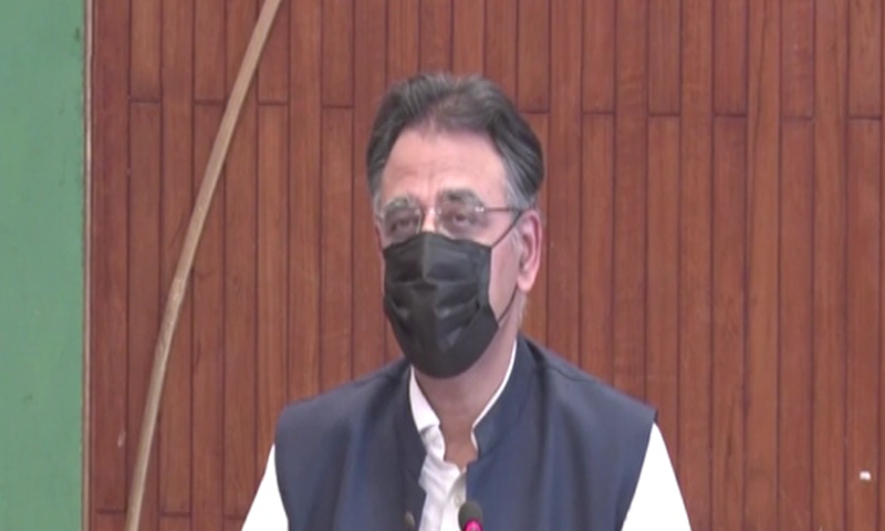 Planning and Development Minister Asad Umar addresses a press conference in Islamabad. — DawnNewsTV