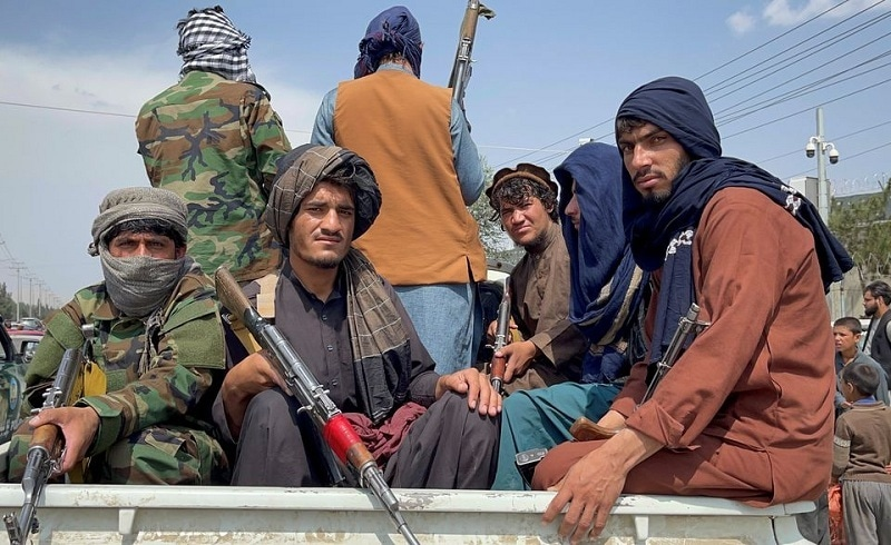 Taliban forces patrol near the entrance gate of Hamid Karzai International Airport, a day after US troops withdrawal, in Kabul on August 31, 2021. —  Reuters