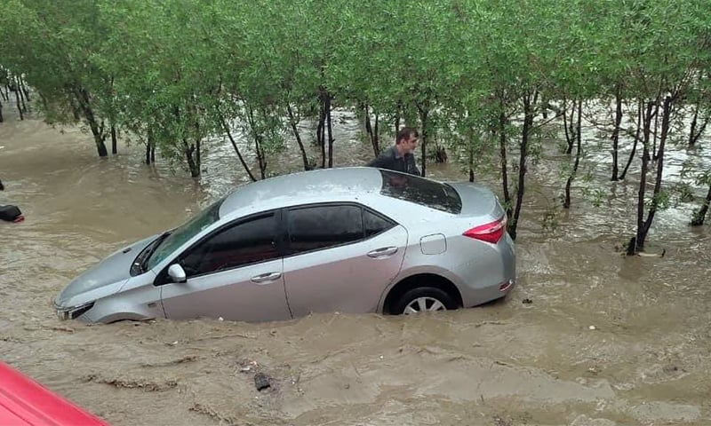 A car is seen submerged after the latest spell of rain in Karachi on Thursday. — Photo: Twitter