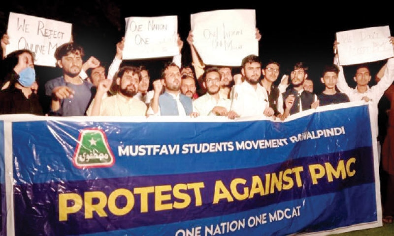Students hold placards and banners during protest outside the PMC office in Islamabad on Thursday. — White Star