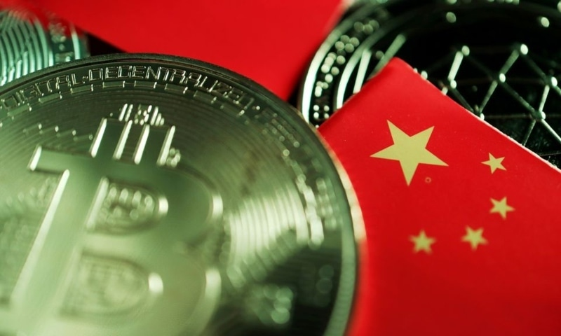 A Chinese flag is seen among representations of Bitcoin and other cryptocurrencies in this illustration picture taken on June 2. — Reuters