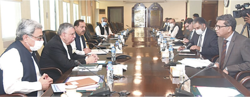 ISLAMABAD: Finance Minister Shaukat Tarin presides over the first meeting of the governing council of Pakistan Single Window on Friday.—APP