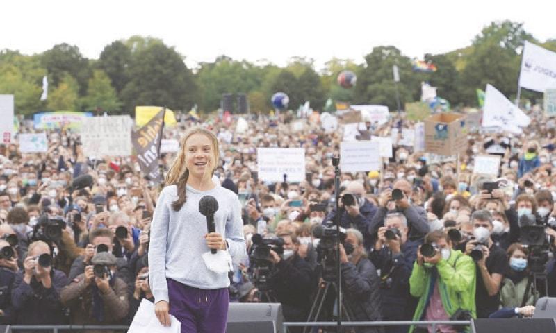 BERLIN: Swedish climate activist Greta Thunberg speaks at a Fridays for Future rally.—AP