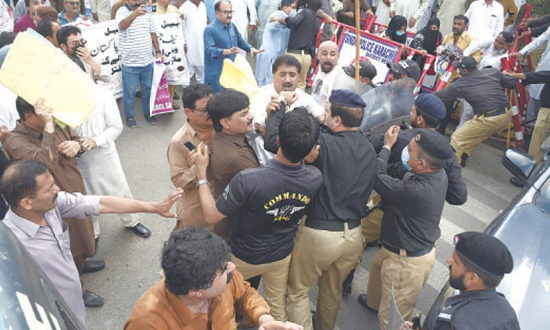 POLICE stop representatives of sacked employees from approaching the Supreme Court registry on Friday.— Online
