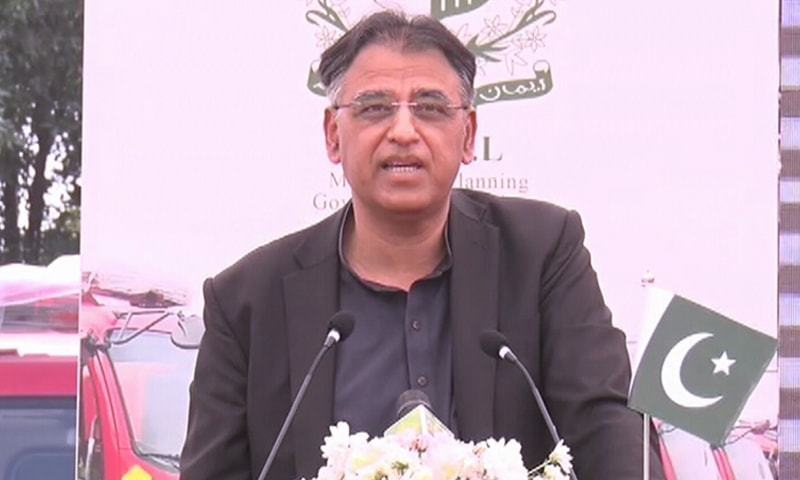 In this file photo, Federal Minister Asad Umar addresses the handover ceremony of 52 fire trucks to the KMC in Karachi. — DawnNewsTV/File