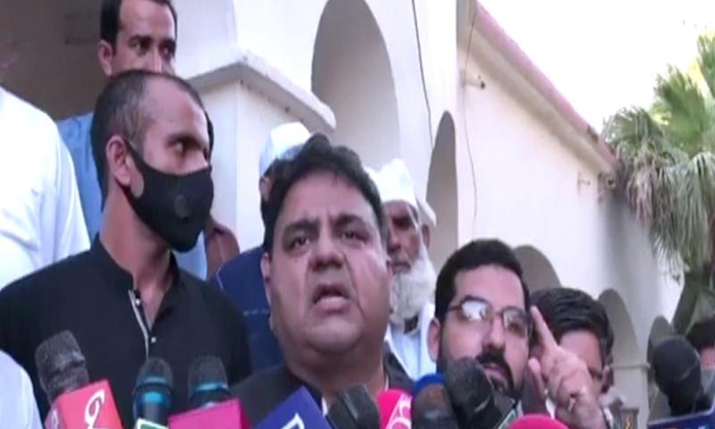 Information Minister Fawad Chaudhry talks to the media in Jhelum. — DawnNewsTV