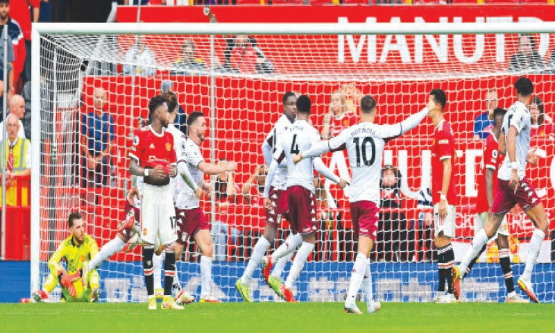 MANCHESTER: Manchester United goalkeeper David de Gea reacts after Aston Villa's Kortney Hause (fifth L) scores during their English Premier League match at Old Trafford on Saturday.—AFP
