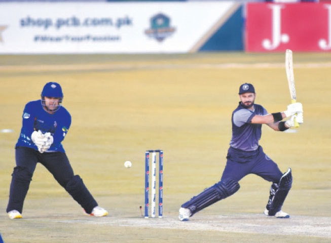 RAWALPINDI: Khyber Pakhtunkhwa's Sahibzada Farhan cuts as Southern Punjab wicket-keeper Azam Khan looks on during their National T20 Cup match at the Pindi Cricket Stadium on Saturday.—Tanveer Shahzad/White Star