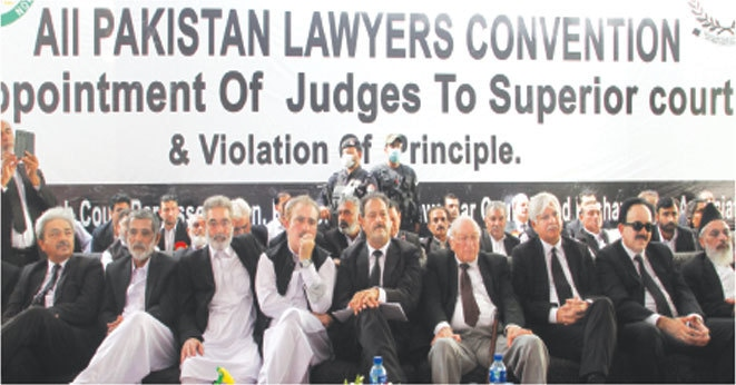 PESHAWAR: Supreme Court Bar Association president Lateef Afridi and other leaders of lawyers sit on the stage during the convention on Saturday.—White Star