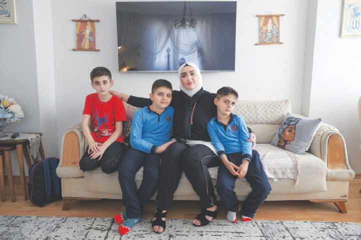 Fatima Alzahra Shon, a Syrian refugee, poses with her children after an interview in Istanbul.—AP