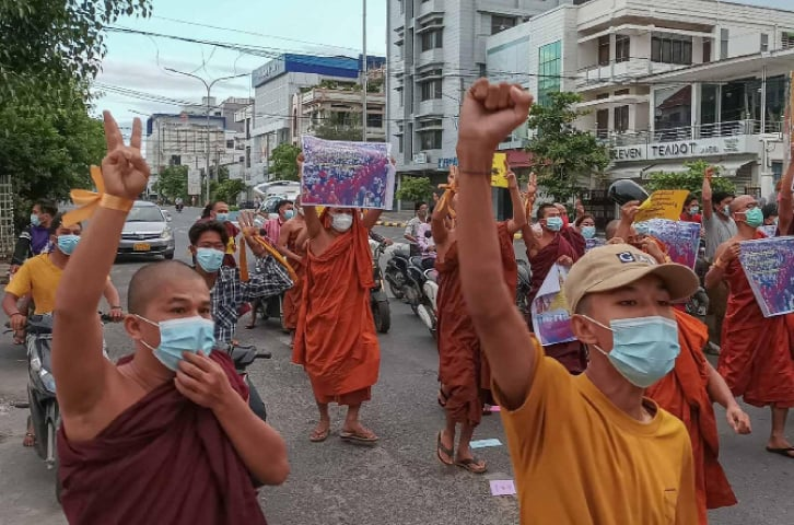 Pro-democracy Buddhist monks and other supporters take part in a demonstration against the junta in Mandalay on Saturday, marking the 14-year anniversary of the 2007 Saffron revolution.—AFP