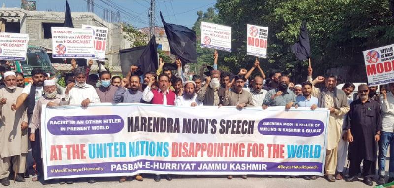 Participants of an anti-India rally chant slogans in Muzaffarabad on Saturday. — Dawn