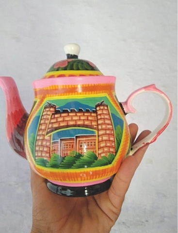 A kettle painted with Bab-i-Khyber