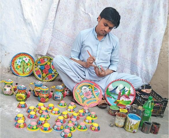 Ismail Khan at work in his studio in Dabgari Garden, Peshawar